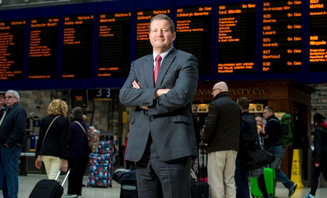 24/04/15 - 15042404 - NETWORK RAIL GLASGOW Phil Verster, Managing Director of the Network Rail/Abellio Scotrail alliance, greets customers and staff alike at Glasgow's Central Station.